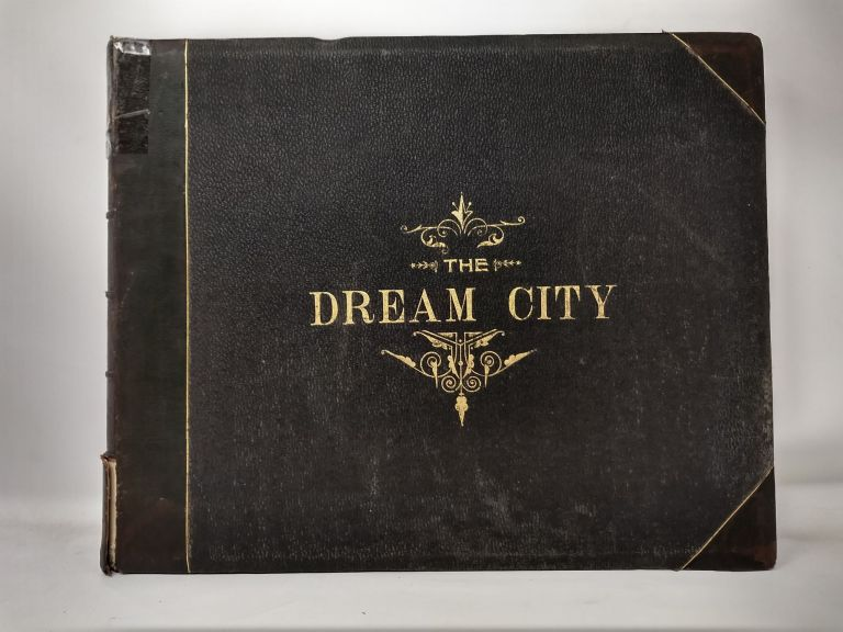 THE DREAM CITY : A PORTFOLIO OF PHOTOGRAPHIC VIEWS OF THE COLUMBIAN EXPOSTION; COMPRISING ITS MARVELOUS ARCHITECTURAL, SCULPTURAL, ARTISTIC, MECHANICAL, AGRIGULTURAL, INDUSTRIAL, ARCHEOLOGICAL, ETHNOLOGICAL, HISTORICAL AND SCENIC ATTRACTIONS; ALSO PRESENTING AND DESCRIBING THE MAGNIFICENT VISTAS, WATER-WAYS, NATURAL SCENERY AND LANDSCAPE EFFECTS. Halsey C. Thompson.