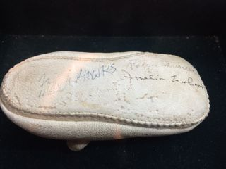 BABY SHOE WITH AMELIA EARHART'S SIGNATURE (AND THAT OF THREE OTHER AVIATORS