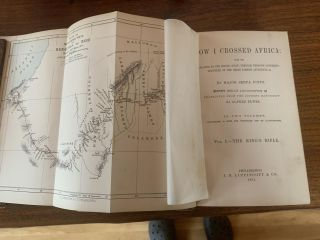 HOW I CROSSED AFRICA. FROM THE ATLANTIC TO THE INDIAN OCEAN THROUGH UNKNOWN COUNTRIES; DISCOVERY OF THE GREAT ZAMBESI AFFLUENTS, &c. (2 VOLUMES, COMPLETE)